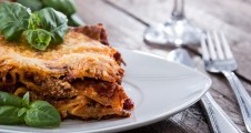 Fresh made Lasagne on a plate decorated with basil